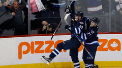 Laine outshines Matthews in battle of top picks