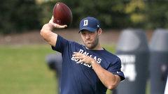 Romo adds practice jersey, helmet to workout