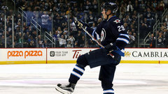 Laine twirls his stick in celebration