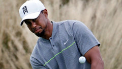 Three bogeys sinks Tiger's hot start