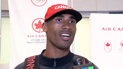 Warner happy to return home with a medal