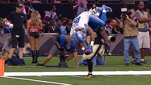 Must See: Tate dodges defenders and flips in for TD