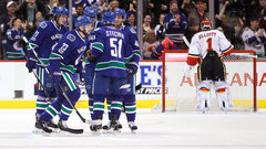 NHL: Flames 1, Canucks 2 (OT)