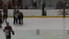 Must See: Hockey player charges at ref and knocks him down