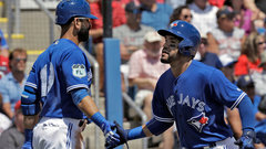 Bautista, Travis won't play for Jays in Montreal