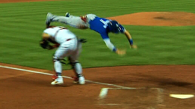 The Keg Must See: Jays' Coghlan flips over Molina to score a run
