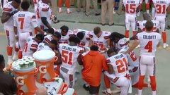 Browns players form kneeling circle during national anthem