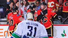 NHL: Canucks 2, Flames 4