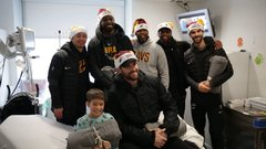 Cavs players spread holiday cheer at local clinic