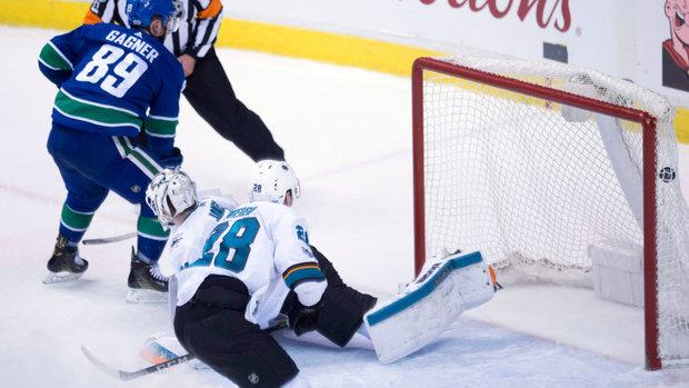 NHL: Sharks 3, Canucks 4 (OT)