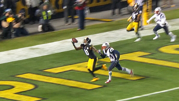 Must See: Bryant makes one-handed TD grab with defender all over him