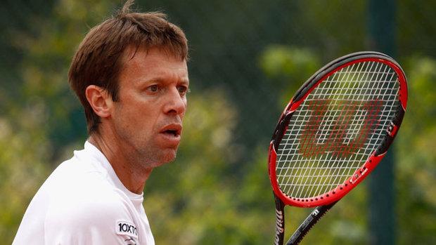 Nestor eliminated in doubles, says it's his last Australian Open