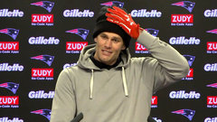 Brady teases media with red gloves, offers no injury update
