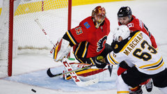 NHL: Bruins 2, Flames 1 (OT)