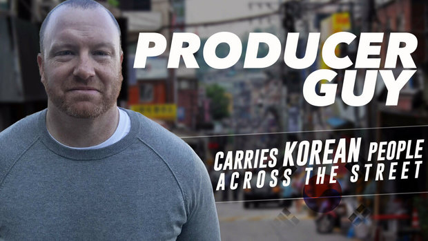 Producer Guy carries Korean people across the street