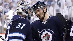 How should the Jets handle RFAs Trouba and Hellebuyck?