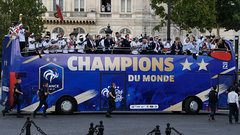 French players receive heroes' welcome after FIFA World Cup win