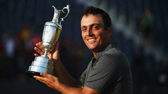First-time major winner Molinari receives the Claret Jug