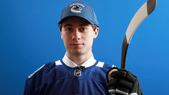 Canucks prospect Hughes will play in Michigan next season